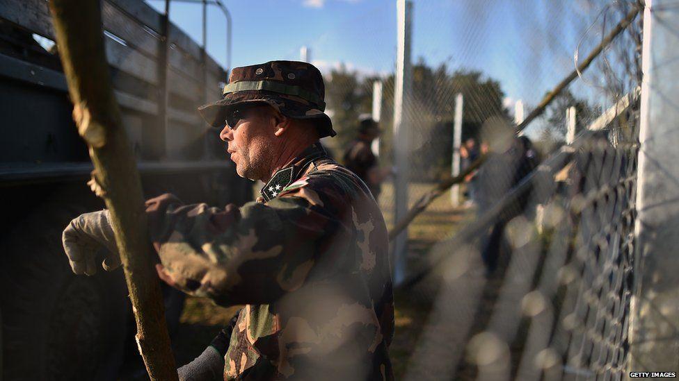Hungarians erect a border fence