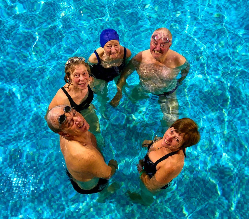 Older people in the water.