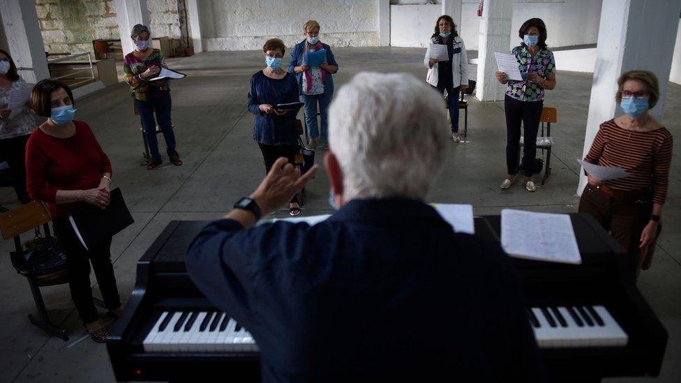 Choir rehearsing in face masks