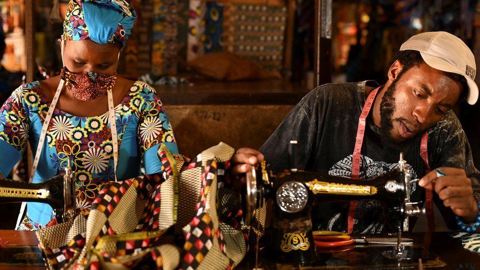 Tailors in Rwanda making traditional African fabric masks