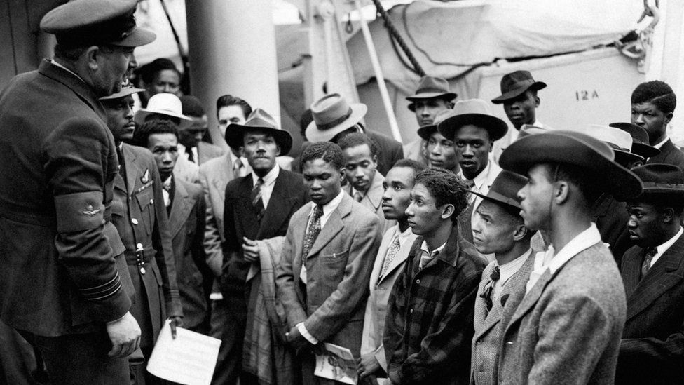 Jamaican immigrants welcomed by RAF officials at Tilbury Docks, Essex, on 22 June 1948
