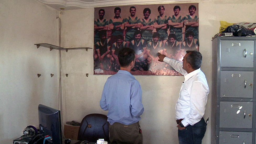Picture of football team on the wall