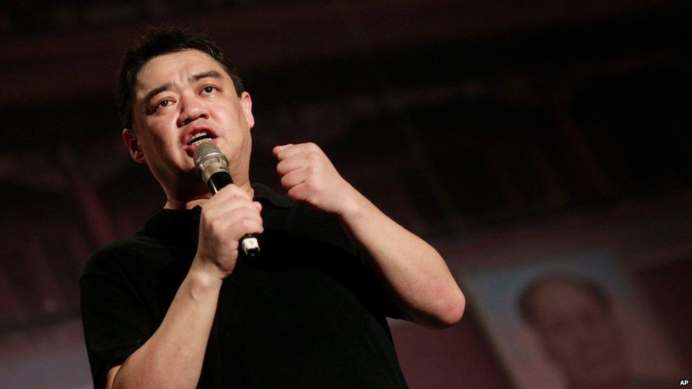 Former student leader in the protests of 1989, Wuer Kaixi, speaks in front of a mock Tiananmen Square backdrop