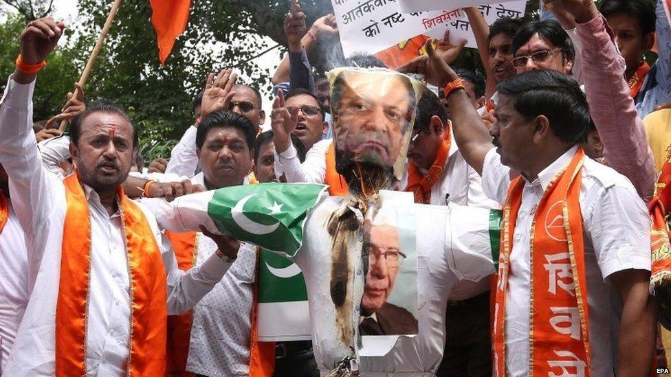 Activists of India's right-wing Shiv Sena burn an effigy depicting Pakistani Prime Minister Nawaz Sharif and his advisor on National Security and Foreign Affairs Sartaj Aziz