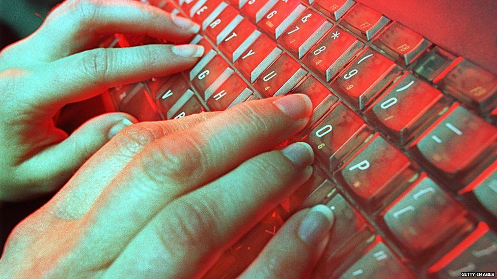 Fingers typing on a keyboard