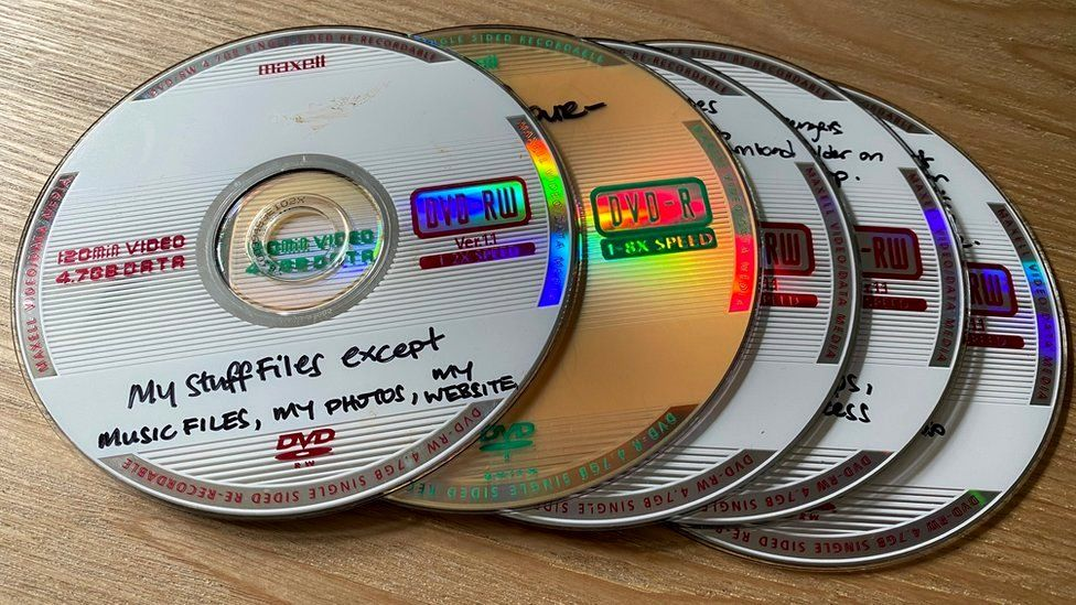 Mary-Ann's DVD backups of personal data, dating back to 2013