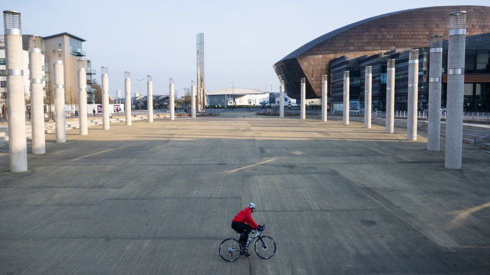 Man on bicycle in Cardiff Bay