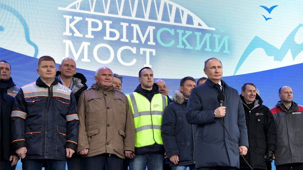 Russian President Vladimir Putin speaks to workers after riding a train connecting the Crimea to mainland Russia in Taman on December 23, 2019
