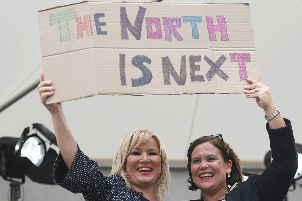 Sinn Féin's Michelle O'Neill and Mary Lou McDonald hold placard saying 'The north is next'