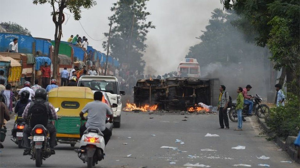 """A truck belonging to the neighbouring state Tamil Nadu burns after it was set on fire by agitated pro-Karnataka activists as the Cauvery water dispute erupted into violence following the Supreme Court""""s order to release water to Tamil Nadu, in Bangalore on September 12, 2016."""