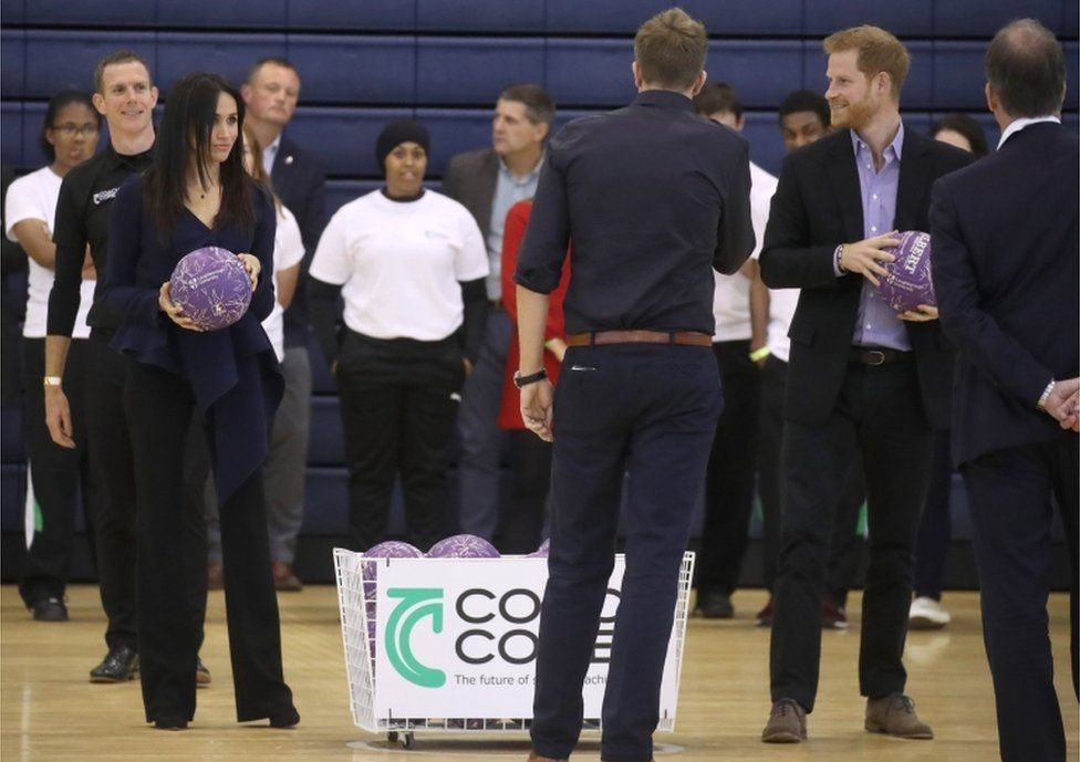 Meghan was seen listening intently before taking on her husband's team