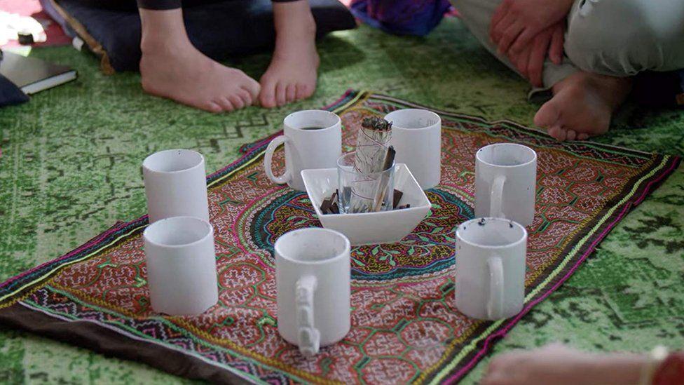 The group prepare to drink their mushroom tea