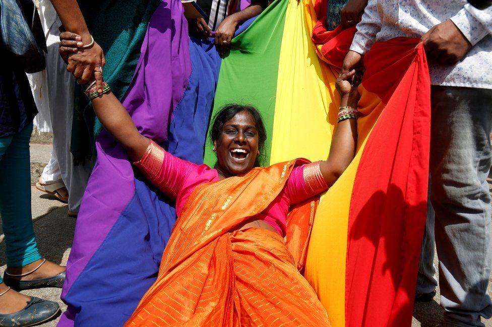 An activist of the LGBT community celebrates after the Supreme Court's verdict