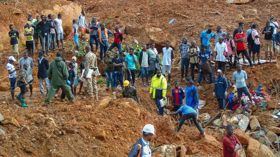 Residents and rescue personnel view damage caused by a mudslide in the suburb of Regent behind Guma reservoir, Freetown, Sierra Leone, 14 August 2017