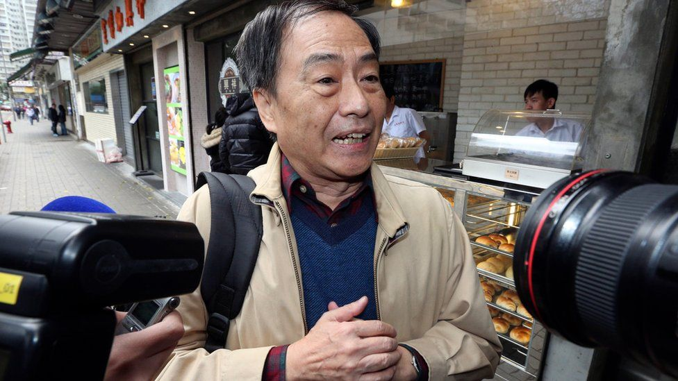 Bookseller Lee Bo speaks to media near his home in Hong Kong Friday, March 25, 2016
