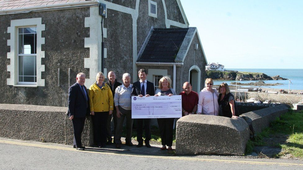 Cemaes CIC receiving a cheque worth £150,000 from the Magnox Socio-Economic Scheme