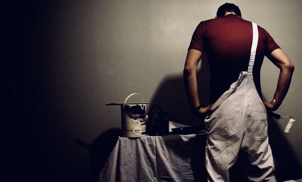 A painter prepares his tools