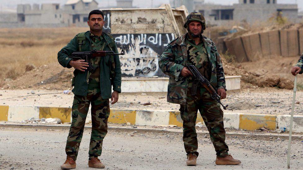Kurdish Peshmerga forces in the town of Sinjar