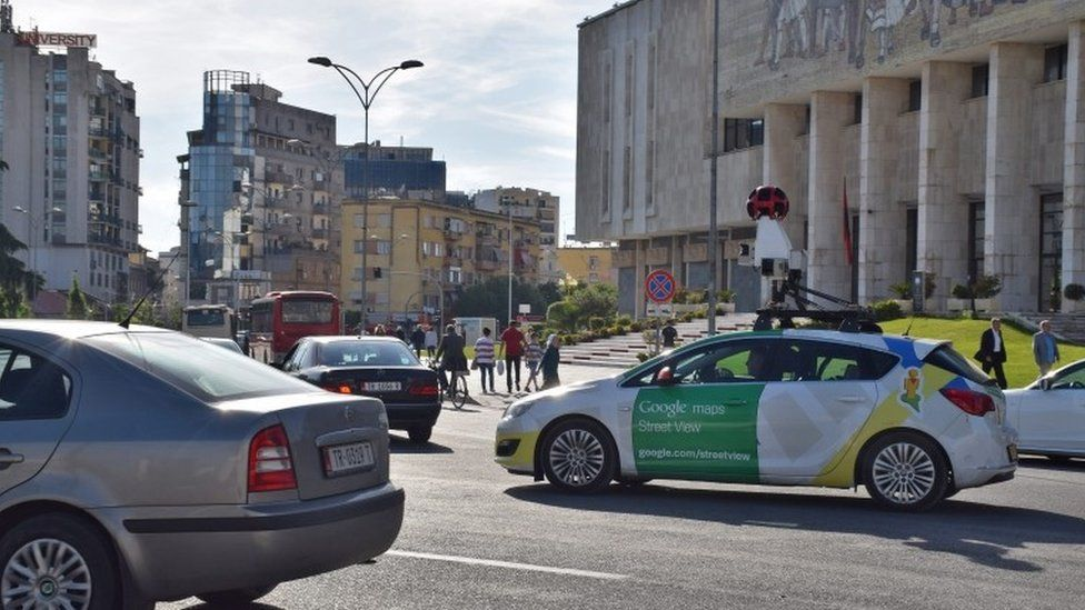 A Google street view car (R) drives through the streets of Tirana, Albania, 01 May 2016.