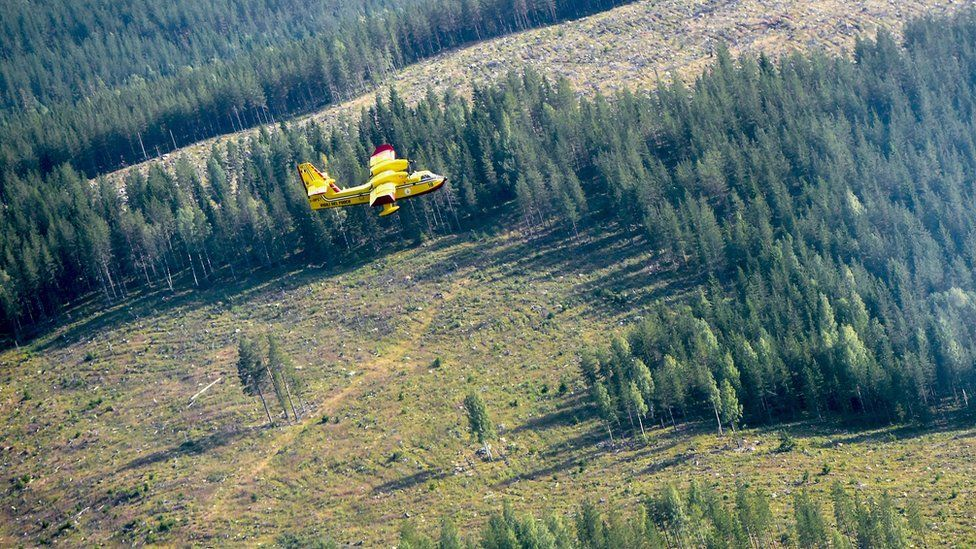 An Italian Bombardier CL-415 SuperScooper in action battling a large wildfire near Ljusdal, Sweden on 18 July 2018