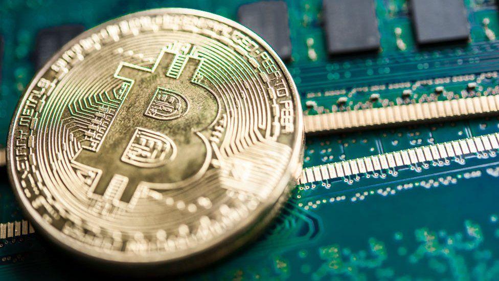 A physical representation of a bitcoin on a circuit board