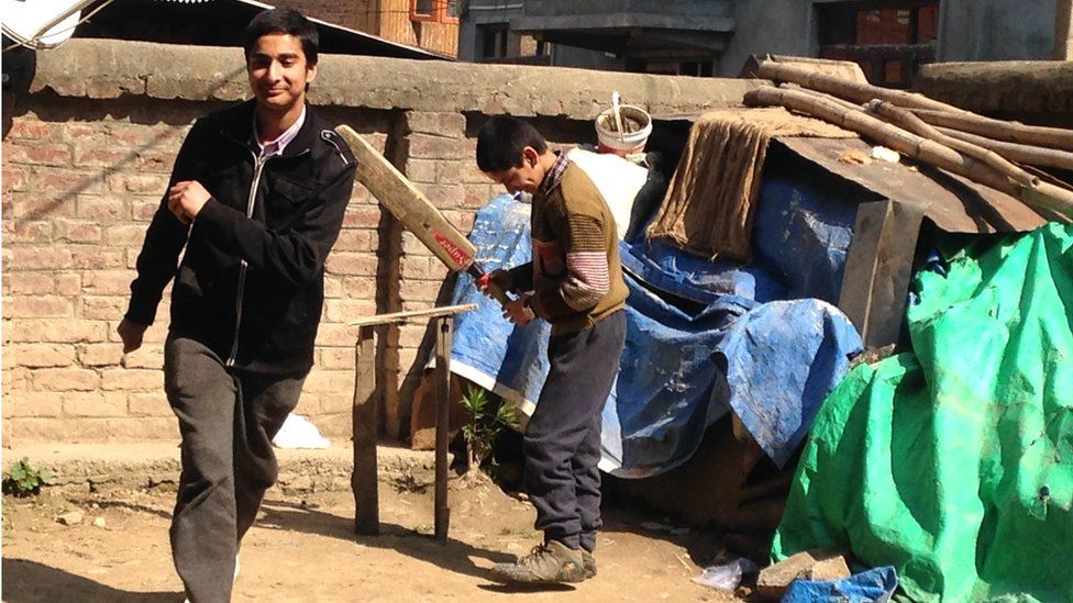 Kashmiri youth play cricket