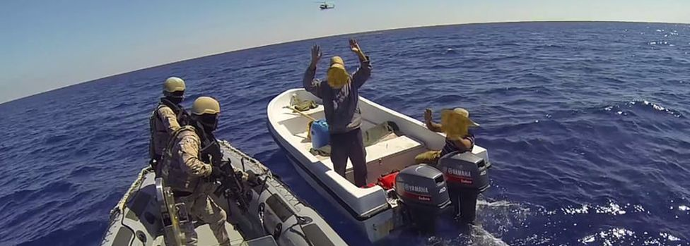A Spanish force boards a boat off Libya