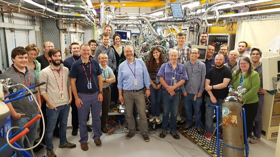 Prof Andrew Evans (front row, third from left) at the opening of the new VERSOX facility at Diamond Light Source