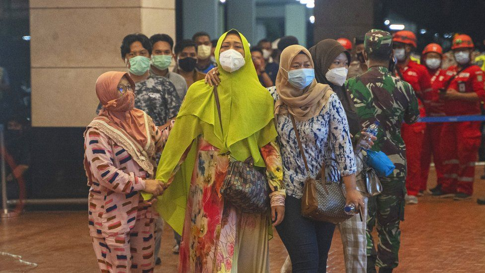 Relatives of people on Sriwijaya Air flight SJ 182 arrive at the crisis centre in Soekarno Hatta Airport, on 9 January 2021 in Jakarta, Indonesia