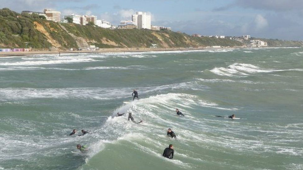 Surfers in the sea at Bournemouth