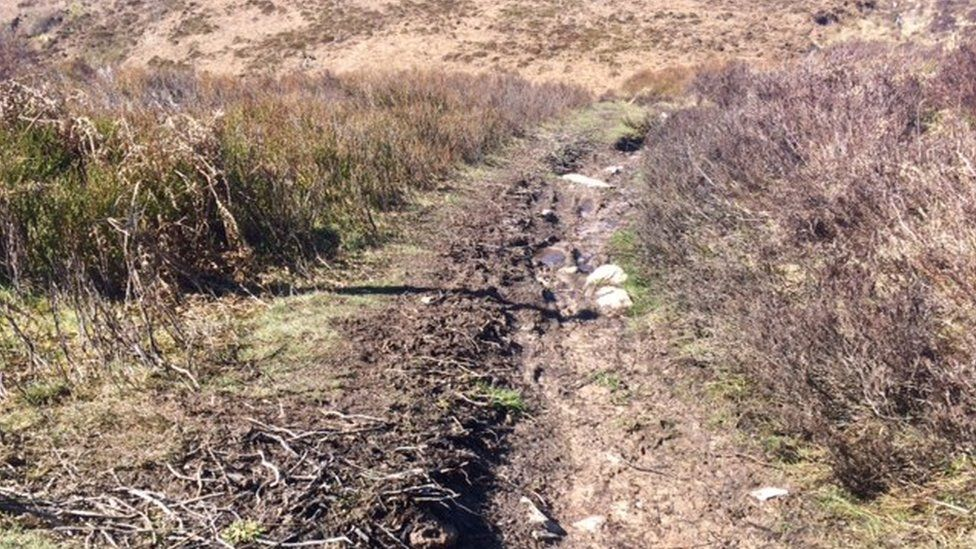 Heather is damaged by route users showing the peat which is then washed away