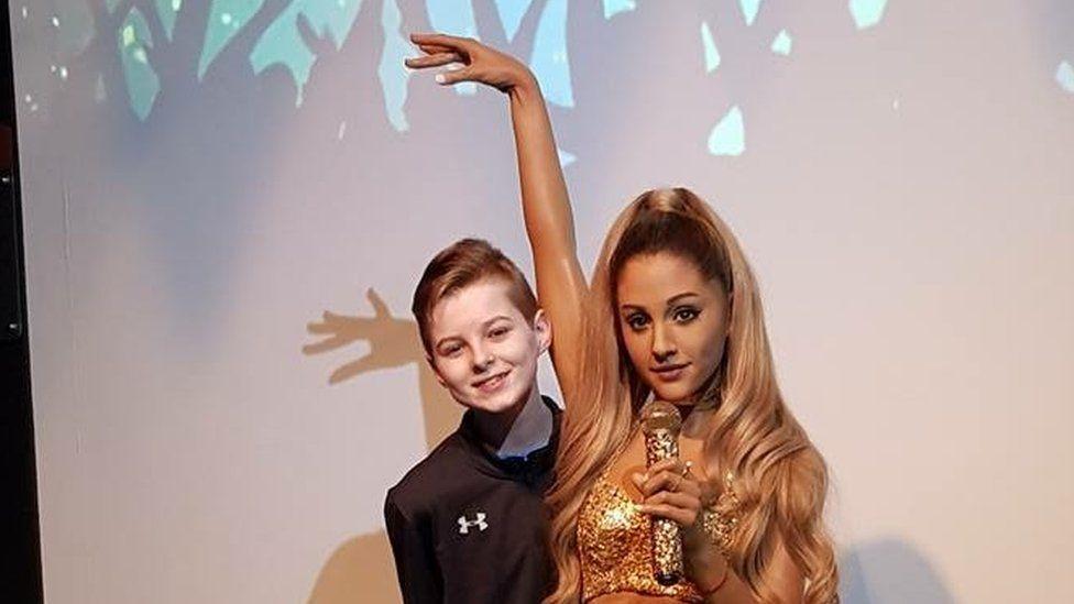 Ciaran with a waxwork of Ariana Grande