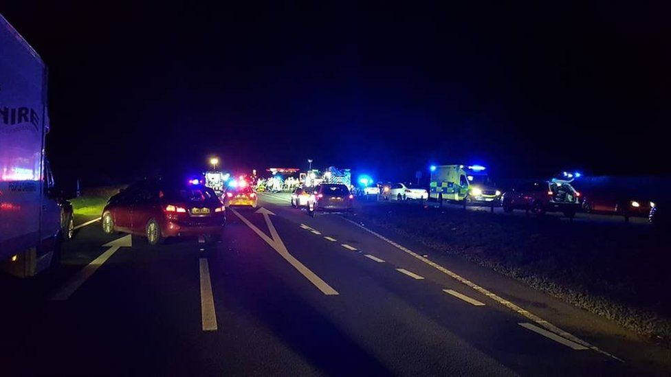 Emergency services vehicles at the crash scene