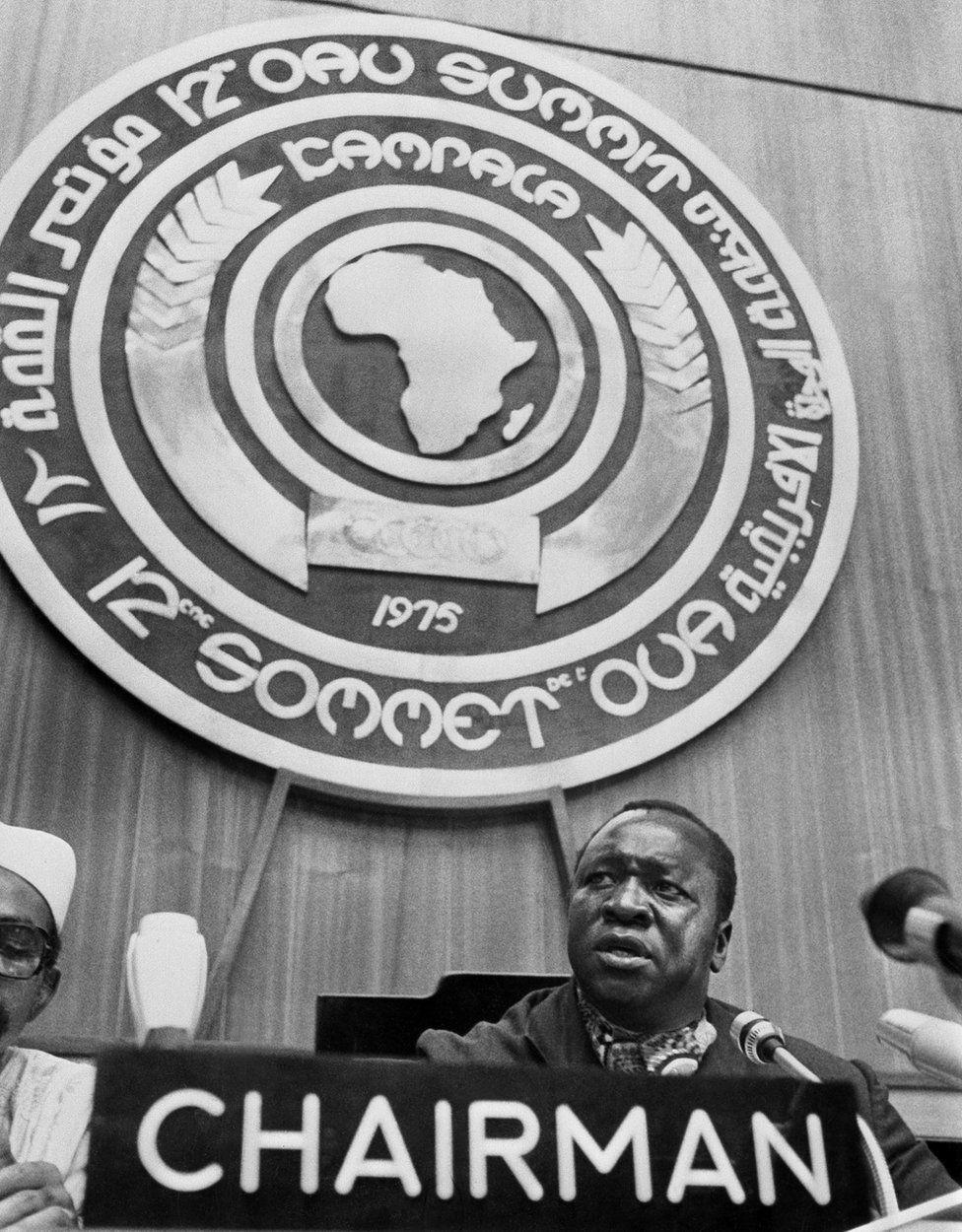 Uganda's President Idi Amin Dada chairs the 12th Organisation of African Unity (OAU) summit in August 1975 in Kampala