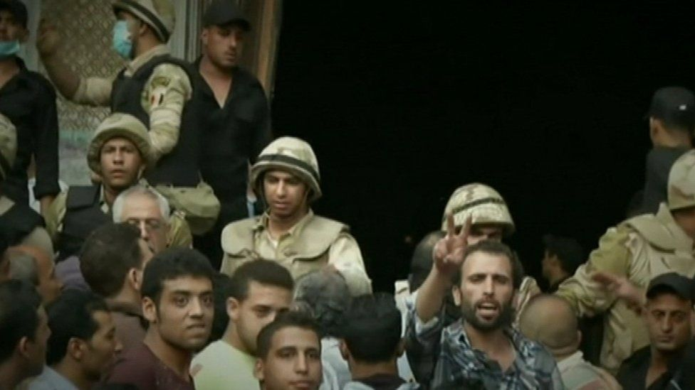 Egyptian security forces during the siege at the Al-Fath mosque in August 2013