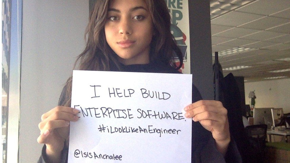 "Isis Anchalee holding up a sign which says ""I look like an engineer"""