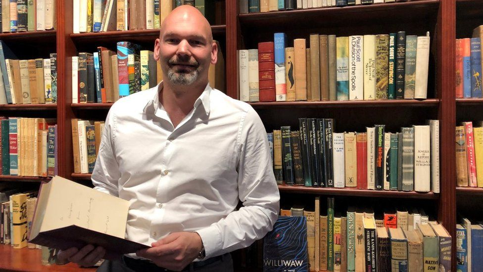 Pom Harrington with books