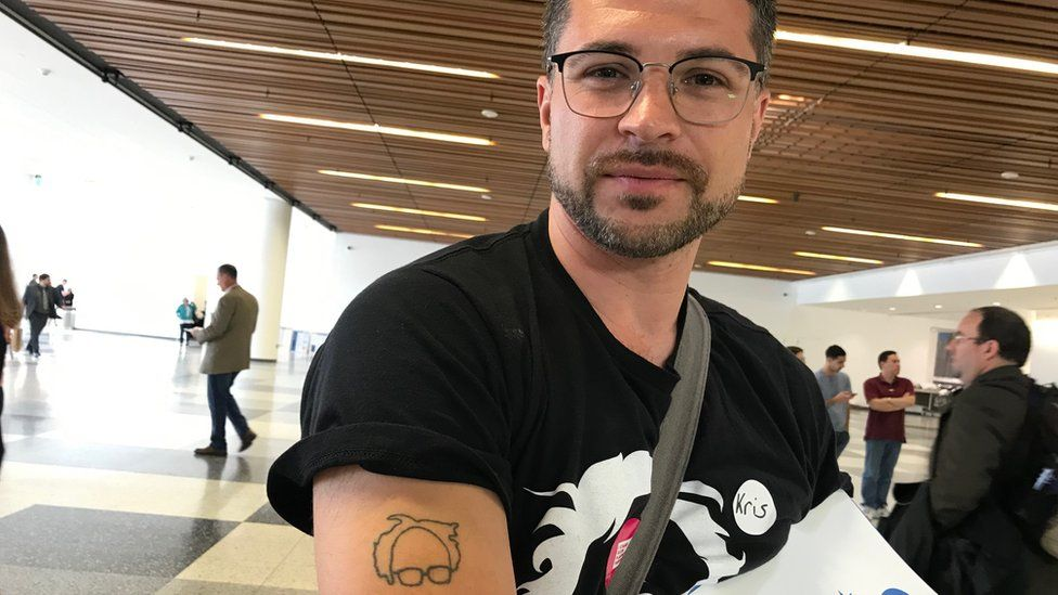 Kristoffer Hellen shows off his Bernie tattoo,