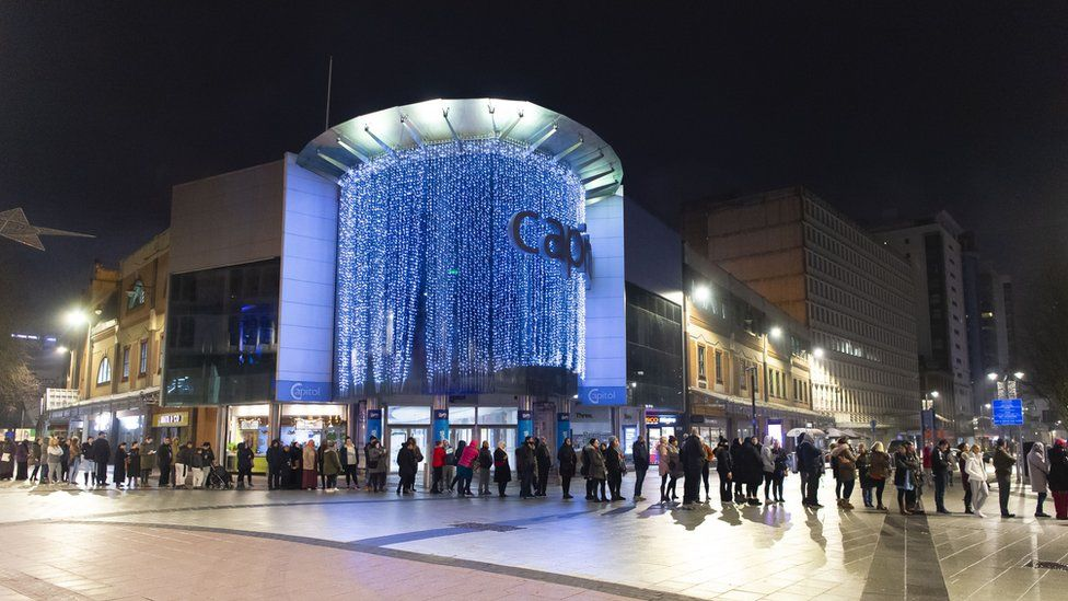 Shoppers queuing in Cardiff