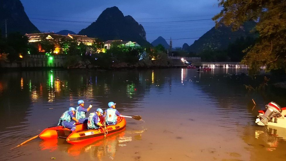 Rescuers search for missing victims in the Peach Blossom River after two dragon boats sank in Guilin, Guangxi Province, China, on 21 April 2018