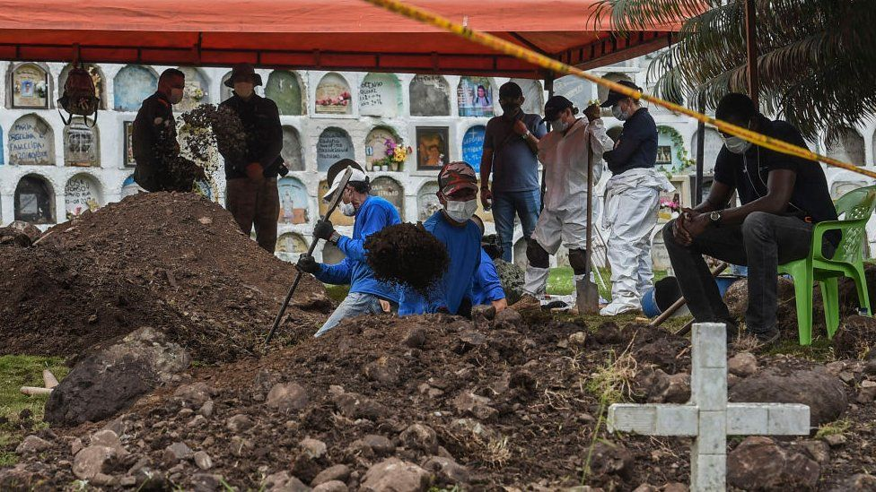 Gravediggers and forensic experts search for the remains of victims executed by members of the Colombian army during the Colombian armed conflict, at the cemetery in Dabeiba, Antioquia department, Colombia, on November 10, 2020. -