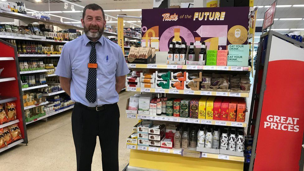 Camden's store manager, Richard Green, stands next to the new range.
