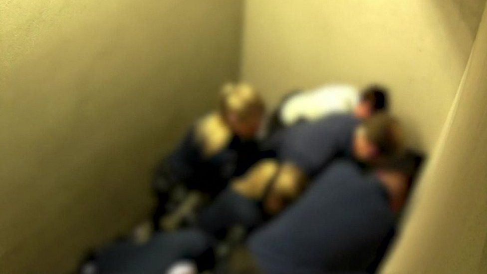 A blurred image shows police holding down Jozef Chovanec after his arrest at Charleroi