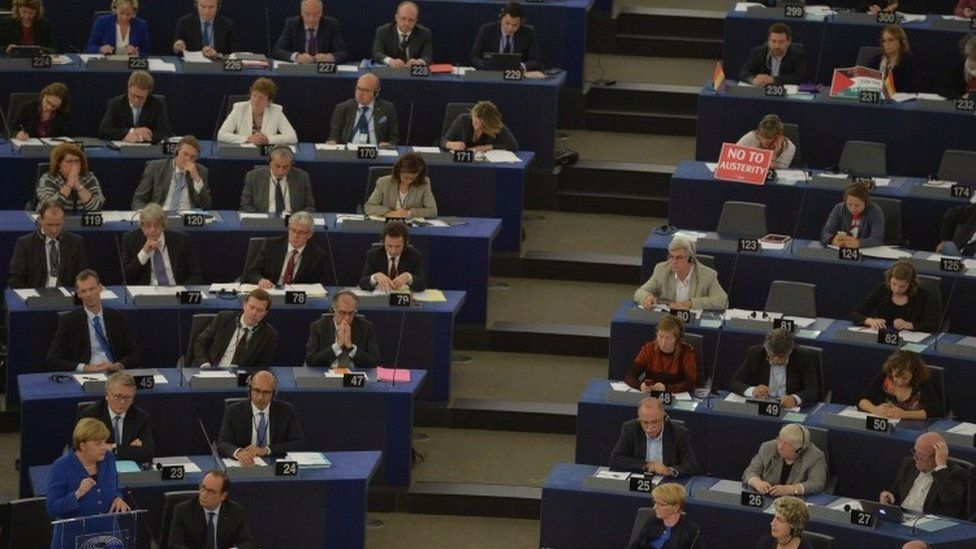 Members of the European parliament listen to a joint address of the French president and the German chancellor at the European Parliament