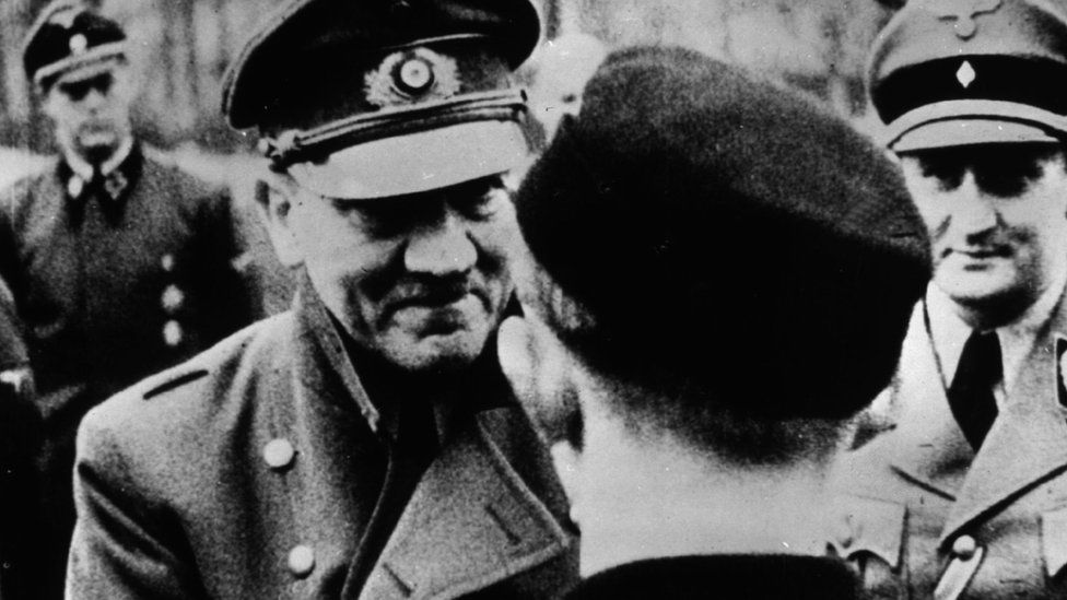Hitler shakes hands with a member of the Hitler Youth in the last official photograph of the Nazi leader, 1945