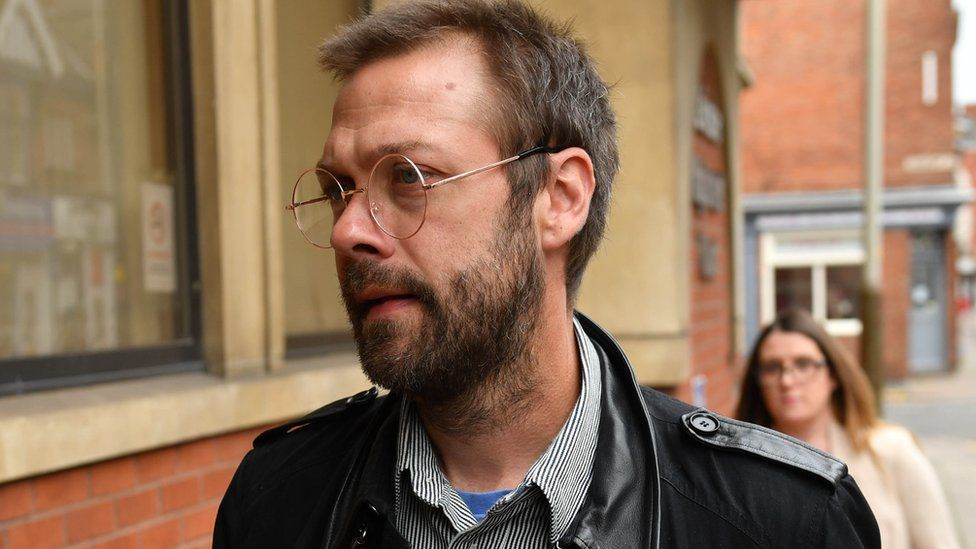 Tom Meighan arriving at court