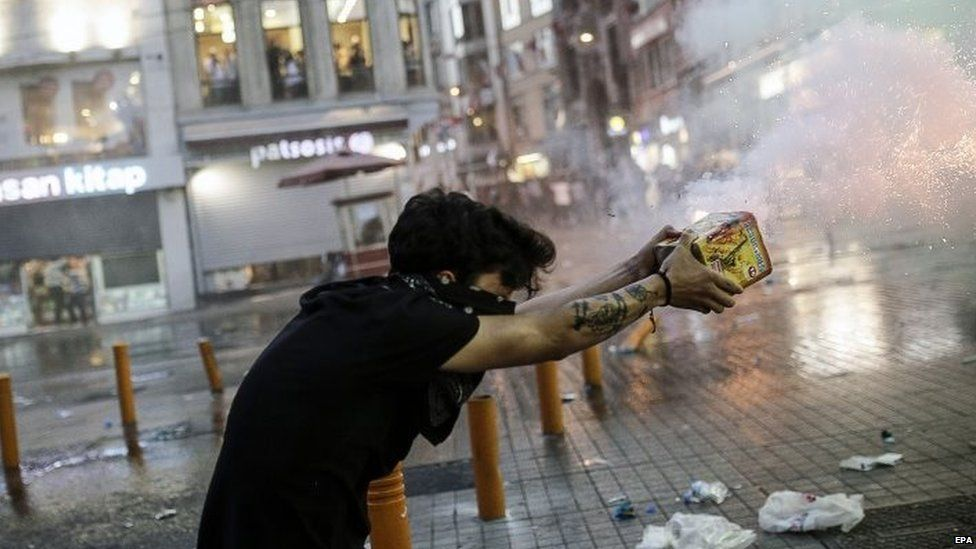 Protesters throw fireworks at Turkish riot policemen firing rubber bullets to disperse them during a demonstration 20 July 2015