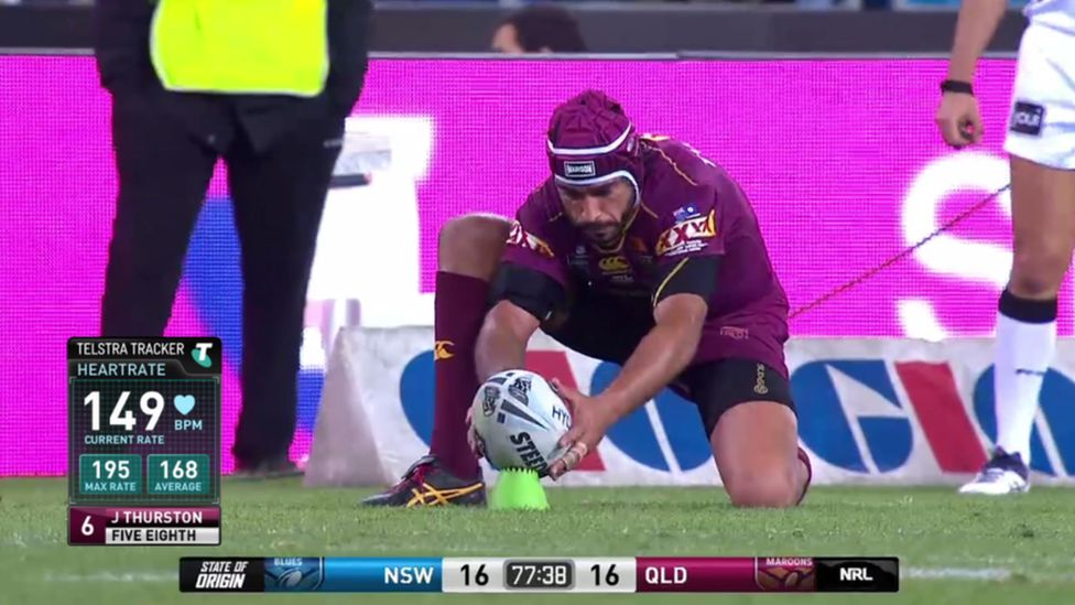 Rugby player Johnathan Thurston about to take a kick