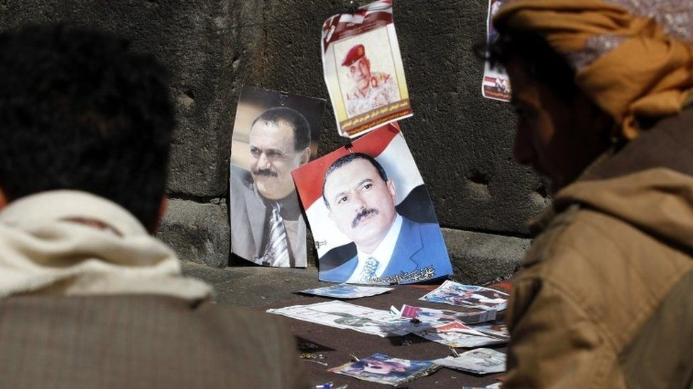 Posters of former Yemeni president Ali Abdullah Saleh are displayed for sale on the sixth anniversary of the 2011 Arab Spring