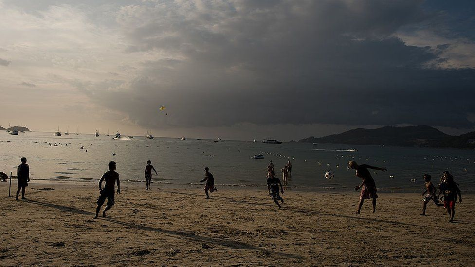 Locals playing football on Patong beach in Phuket